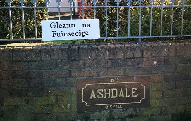 Antrim and Newtownabbey Planning Office threatens prosecution over an Irish language road sign.