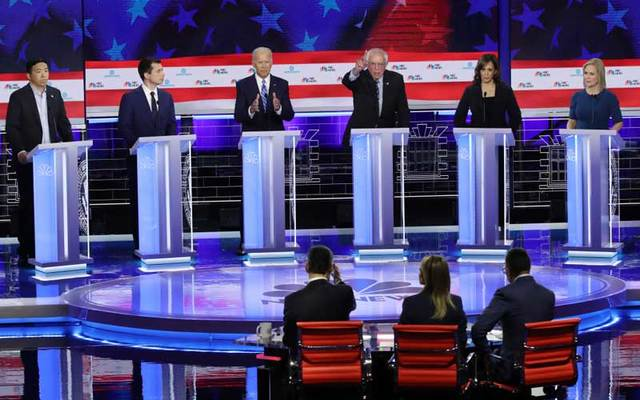 Democratic presidential candidates (L-R) Andrew Yang, Pete Buttigieg, Joe Biden, Bernie Sanders, Kamala Harris, Kirsten Gillibrand take part in the second night of the first Democratic presidential debate on June 27, 2019 in Miami, Florida.