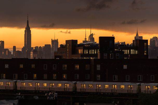 A view of Midtown Manhattan taken from Bushwick, Brooklyn at sunset.