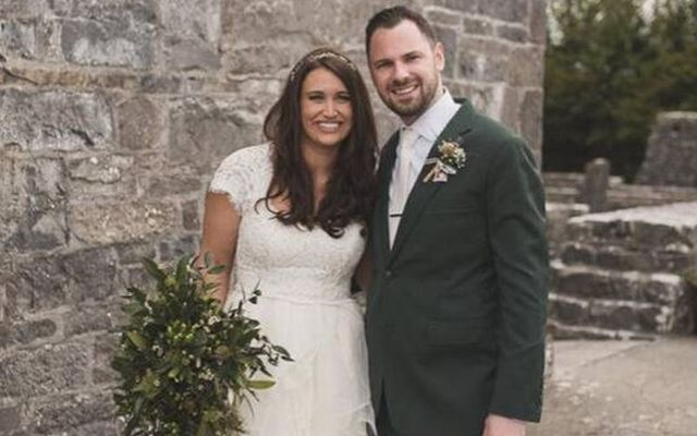 Caitlin Holtzman and John Heneghan on their wedding day: The couple were killed in a fatal road crash on May 25.