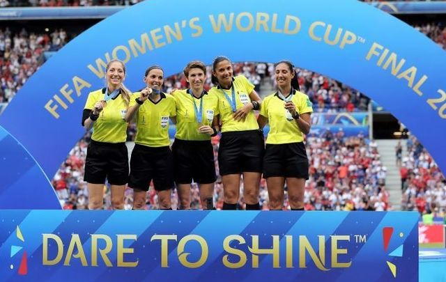 Michelle O\'Neill (center) was the first Irish female to referee a FIFA World Cup soccer match.