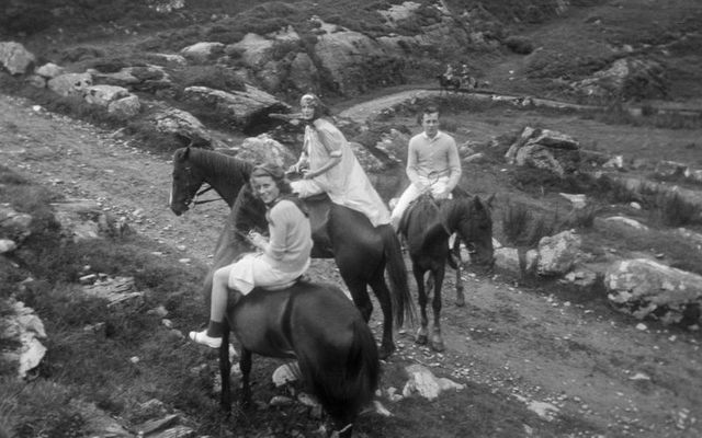Kathleen Kennedy (left) rides on horseback with an unidentified woman (center) and an unidentified boy through the Gap of Dunloe in Killarney National Park, Killarney, Ireland, during a Kennedy family trip in 1937.