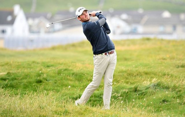 Cormac Sharvin of Northern Ireland plays his second shot on the third hole during Day Four of the Dubai Duty-Free Irish Open at Lahinch Golf Club on July 07, 2019, in Lahinch, Ireland.