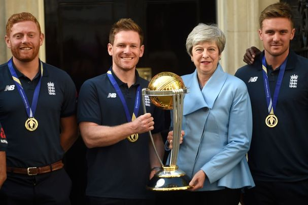 Jonny Bairstow, Eoin Morgan, and Theresa May pose with the Cricket World Cup at Downing Street on July 15, 2019, in London, England.