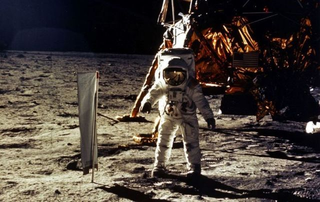 "On July 20, 1969, Neil Armstrong became the first man to walk on the moon, making good on JFK\'s famous ""moon speech.\"""