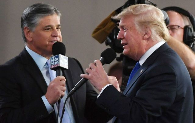 Fox News Channel and radio talk show host Sean Hannity (L) interviews U.S. President Donald Trump before a campaign rally at the Las Vegas Convention Center on September 20, 2018, in Las Vegas, Nevada.