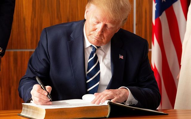 MI Donald Trump signing the visitor\'s guest book at Shannon Airport, in June 2019.