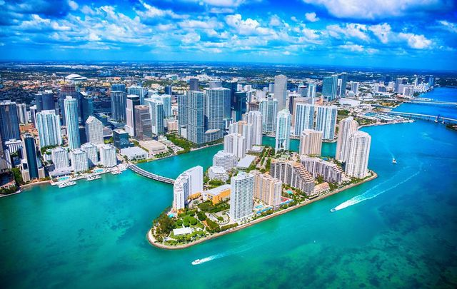 Miami Florida\'s downtown district shot from an altitude of about 1000 feet over the Biscayne Bay during a helicopter photo flight.
