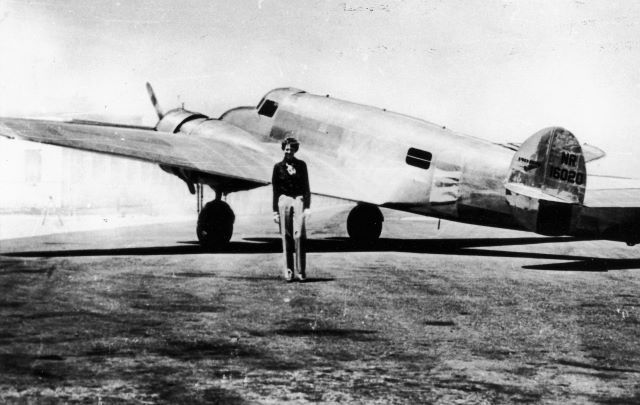 Amelia Earhart with her plane Electra, circa 1937.