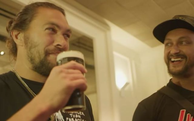 Jason Momoa enjoys a Guinness with Mada Abdelhamid at Momoa\'s surprise 40th birthday party.