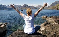 Thumb_mi_ireland_vacation_wuhew_hands_up_woman_back_sea_istock