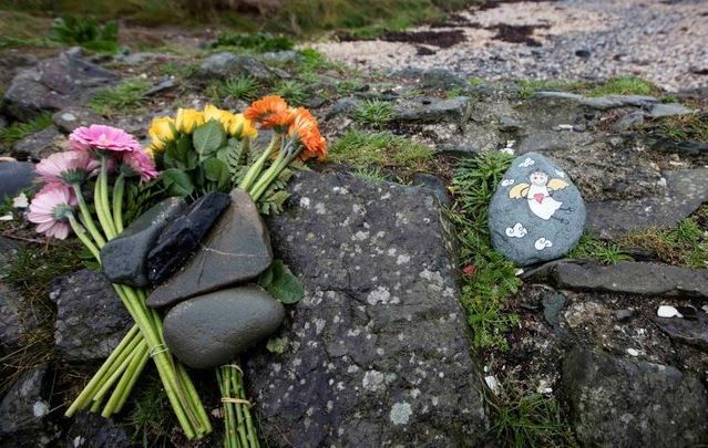 Locals had left flowers on the beach where Baby Belle was discovered in December.