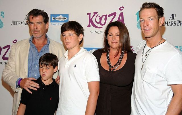 Actor Pierce Brosnan (L) and family arrive for the Cirque Du Solei Opening Night Gala For Kooza at the Santa Monica Pier on October 16, 2009, in Santa Monica, California.