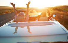Thumb_mi_old_couple_driving_sunset_getty