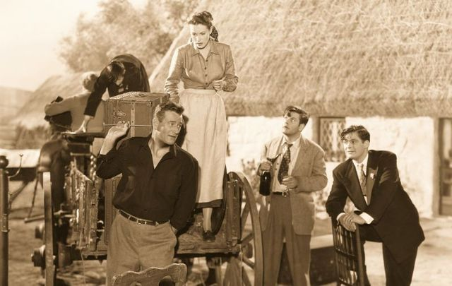 "(L to R) John Wayne, Maureen O\'Hara, Sean McClory and Charles Fitzsimons on the set of ""The Quiet Man\"" directed by John Ford circa 1952."