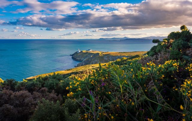 A view of the Bailey Lighthouse, along the running track on Howth Head, Dublin.