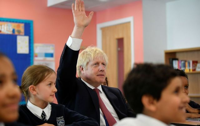 Britain\'s Prime Minister Boris Johnson attends a year six history class with pupils during a visit to Pimlico Primary school on September 10, 2019, in London, England.