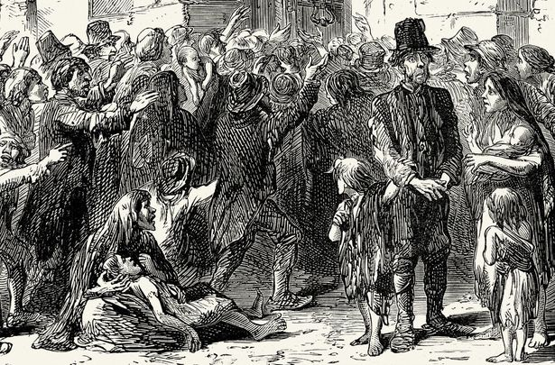 Victims of Ireland\'s famine clamber at the gates of a workhouse.