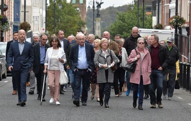 Family members of Bloody Sunday victims walked together to the courthouse in Derry on September 18.
