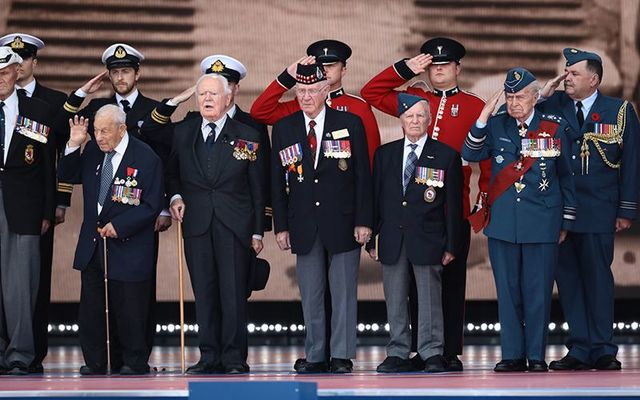 Veterans stand on stage during the D-Day Commemorations on June 5, 2019 in Portsmouth, England
