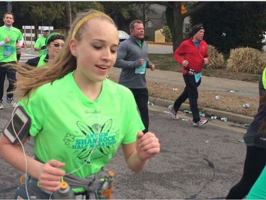 Cameron Gallagher running in the Virginia Beach Shamrock half Marathon. She collapsed after crossing the finish line and later died at an area hospital.