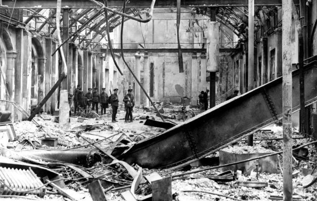 Soldiers survey the interior of the completely wrecked Post Office in Sackville Street, Dublin, during the Easter Rising of 1916.