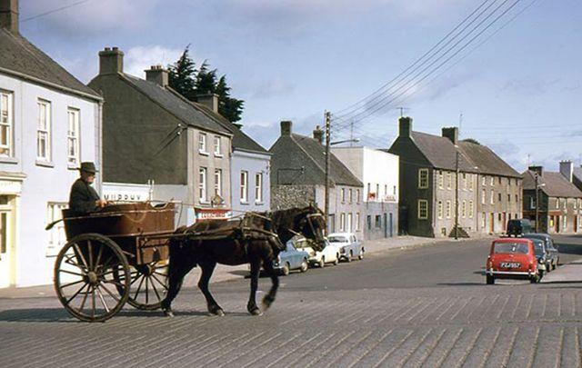 A horse and trap crossing Bridge Street, Graiguecullen, Co Carlow.