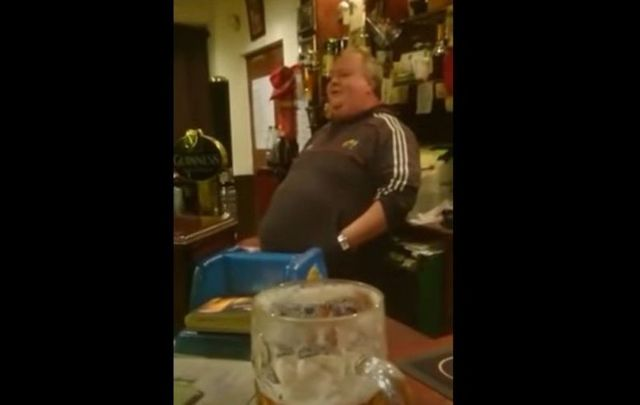"Cork barman John Horgan sings Mary Black\'s ""Bright Blue Rose"" as he serves his patrons."