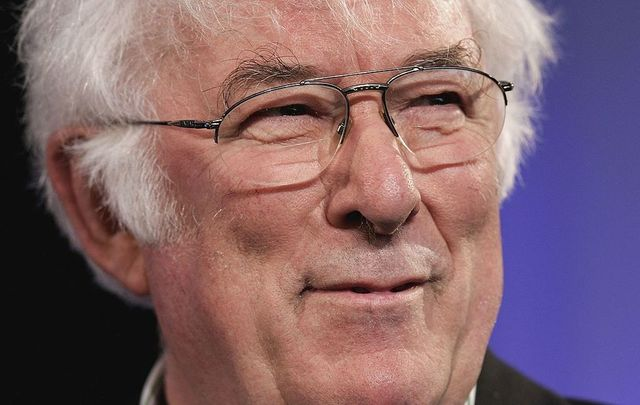 Poet Seamus Heaney reads from his new book of poetry, District and Circle, at the Guardian Hay Festival on May 29, 2006, in Hay-On-Wye, England.