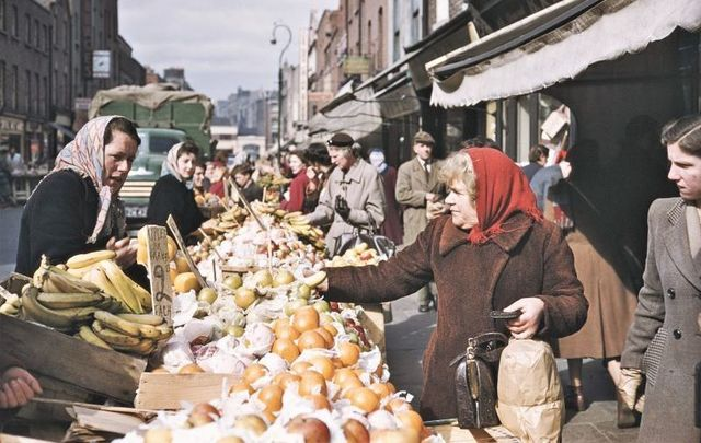 Shoppers at a fruit stall on a street in Dublin, Eire, June 1955. How history, oral tradition, and literature can remind us of Ireland\'s great tradition of food.