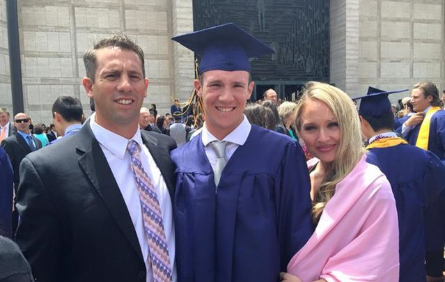Calvin Riley at his high school graduation. The college sophomore and baseball player was shot dead Saturday night in what appears to be a horrific random attack.