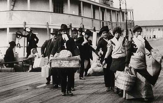 Emigrants landing at Ellis Island, New York: Emigrants have two homes, two places where they have to take us in – and hurray for that.