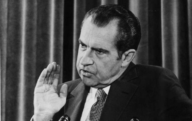 American President Richard Nixon giving a press conference.