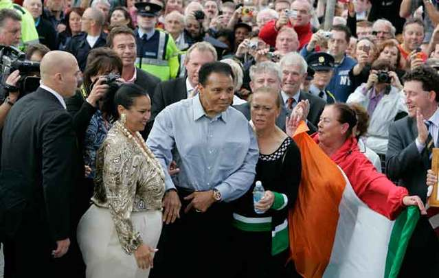 Muhammad Ali arrives at Turnpike Road in Ennis, County Clare,  the location of the birthplace of his great grandfather Abe O\'Grady, with his wife Yolanda (lonnie) right, in 2009.