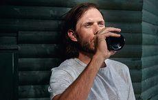 Thumb cut beer drinking man istock