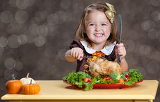 Thumb_cut_carving_up_a_turkey_thanksgiving_little_girl_istock