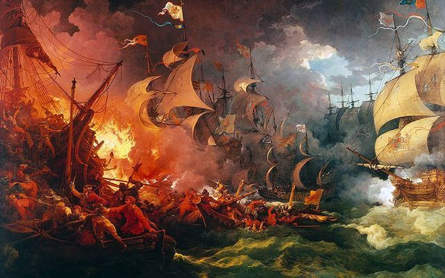 """Who were the black Irish? Some say they came from the Spanish Armada. (\""""Defeat of the Spanish Armada\"""", painted by Philip James de Loutherbourg)."""