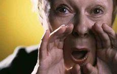 Thumb curse shout woman getty