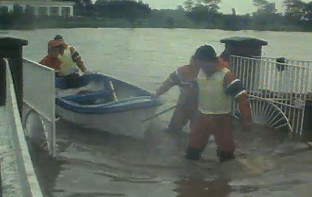 Rescuers battle the flood waters of Hurricane Charley in 1986.