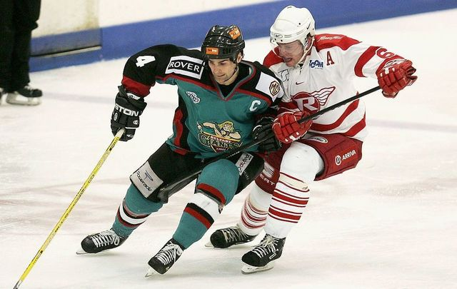 Shane Johnson of the Belfast Giants battles with Mark Gouett of the London Racers during the Elite League match between London Racers and Belfast Giants at the Lea Valley Ice Centre on December 3, 2004, in London.