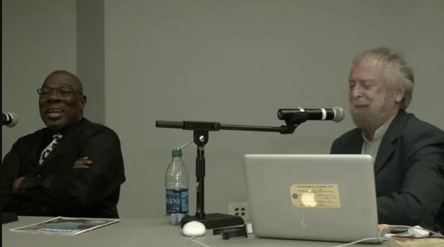 "Lenwood Sloan and Paddy Moloney speaking at the \""Black-Irish Identities: A Symposium"" at Glucksman Ireland House, New York."