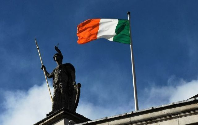 The flag of Ireland flying above Dublin\'s GPO during 1916 commemoration ceremonies