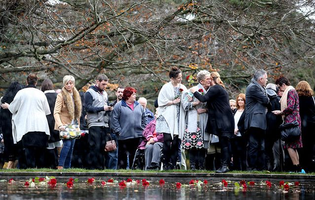 Families gather to lay roses on Ireland's third Missing Persons' Day on December 2.