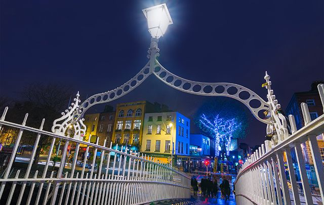 Dublin\'s Ha\'penny Bridge overlooking the Temple Bar area at Christmas time in Dublin.
