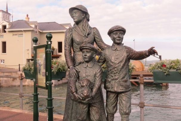 A statue dedicated to Annie Moore and her younger brothers in Cobh.