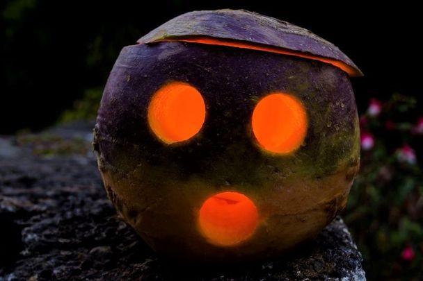 Spooky! A jack-o-lantern made from a turnip.