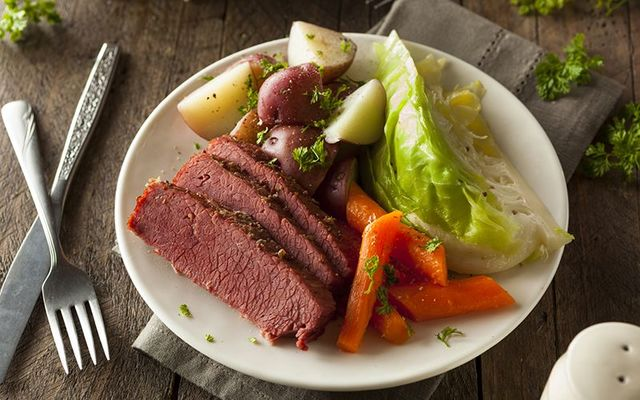 The Irish American tradition of eating corned beef and cabbage, rather than the traditional Irish bacon and cabbage.