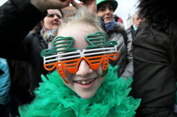 March 17, 2017:  A child from Wexford watching the St Patricks Day Parade in Dublin city.