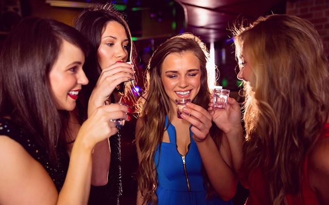 A group of girls taking shots.