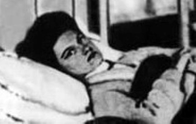 """Mary Mallon - \""""Typhoid Mary\"""" - sick in her hospital bed in 1909."""